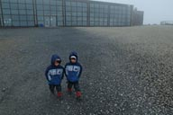 Twin boys in front of Nordkapp building.