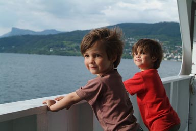Boys looking over reiling, ferry Norway.