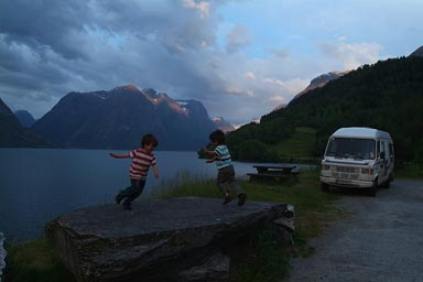 Sogne Fjord, camp, boys dance on table.