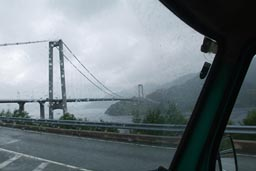 Drive in rain, bridge over fjord.