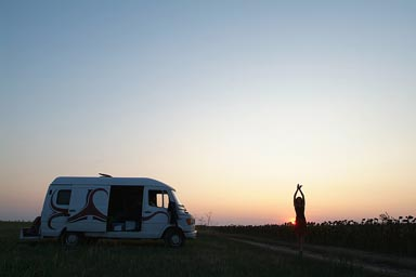 Danube Delta, camp, Christina in front of setting sun, dancing.