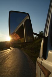 Me looking quit happy through mirror of the MB307, sunny evening after entering Romania.