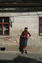 Christina, in Brasov, Romania, in boots and skirt.