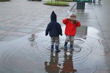 Boys in puddle on Nevsky Prospect.
