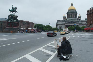 Painter in front ofSaint Isaac's. Petersburg.