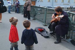 Boys amazed by guitarist, S. Petersburg.