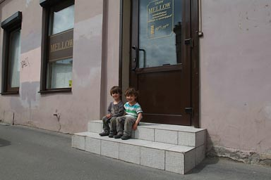 Boys, St. Petersburg, on steps.