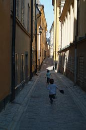 The boys roam the alleys of Stockholm.