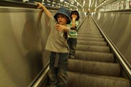 Moving staircase, Stockholm underground, twin boys with hats