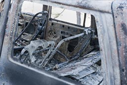 Back seats, where we sat after car explosion, completely burnt out Ford Explorer.