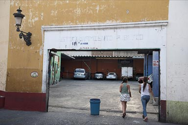 Girls enter garage, Guadalajara.
