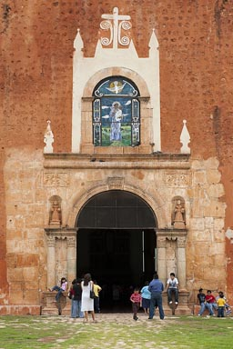 Sunday mass, Ticul in Yucatan, people standing outside church.