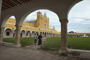 Izamal, Yucatan. Priest walking over atrium, Franciscan convent.
