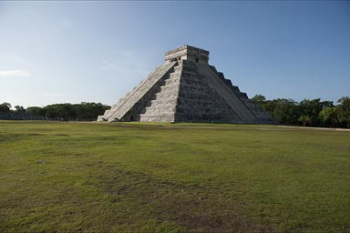 Chichen Itza, Great Pyramid. Early morning. View on the two restored sides, one in shade.