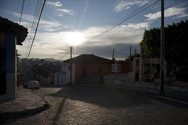 Small steep hilly street in Comitan, Chiapas, early morning.
