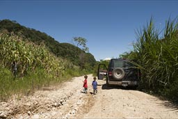 Between corn fields, the road from Guadalupe Tepeyac to Realidad, ran  the van stuck. The boys enjoy the break.