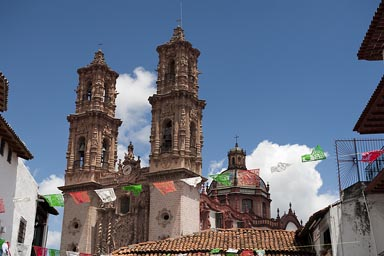 Taxco; Santa Prisca Church over roofs.