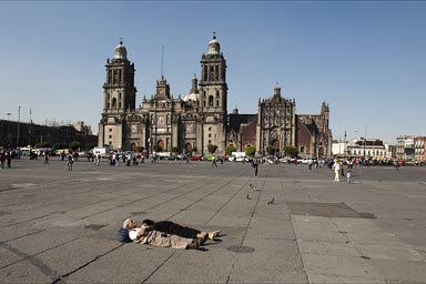 El Zocalo, old couple sleeping on ground, Mexico City..