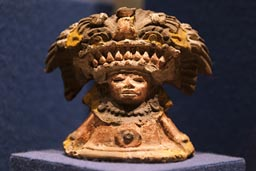 Little stone statue feathered decoration for the head, museum, Teotihuacan, Mexico.