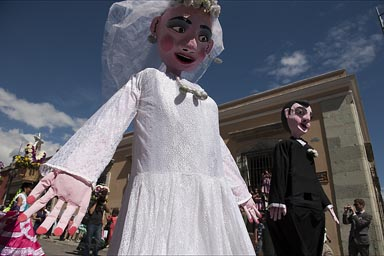 Marriage figures, puppets in a street parade, Oaxaca.