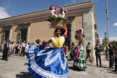 Flower girls in marriage parade, street Oaxaca