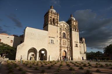 Santo Domingo cathedral, Oaxaca, mescal cacti in front, deep blue evening sky.