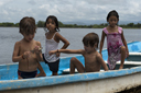 Mexican/Austrian/Moroccan curiosity, the lagoon in Boca del Cielo, Chiapas, a boat, 2 boys, two girls.