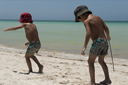 What is here to do?  On Playa Colorada, boys search on white sandy beach what to do.