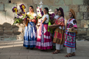 Girls and flower baskets, Oaxaca.