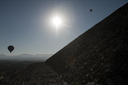 Balloons, sun over Pyramid of the Sun. Teotihuacan, Mexico.