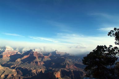Blue skies, Grand Canyon and snowy tops.