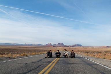 Asians, posing for photo, Monument Valley Road.