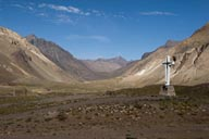 Concret cross, valley in Argenina. view towards Chile.