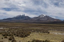 Pomerape, Parinacota in Chile as seen from Bolivia.