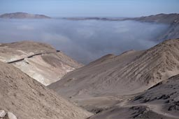 Coming from above, Lluta valley is full of fog, early morning. Northern Chile.