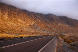 Evening light on desert mountains in the fog, near Paposo, Chile.