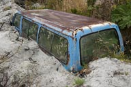 Chaiten, a minibus submerged by ash and debris that came with the lahar, following the volcano eruption.