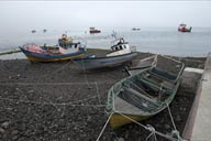 Boats on pebble beach, Hornopiren.