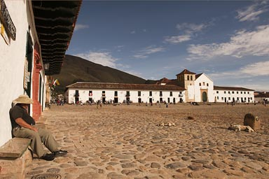 Man on bench tranquillo, main square Villa de Leyva, Colombia.