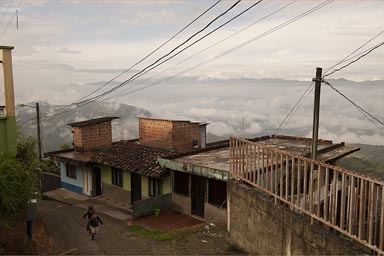 My boys run up a street, early morning Santa Barbara, Antioquia, central Colombia.