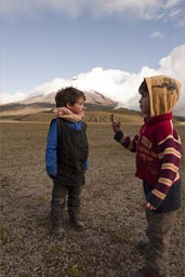 Boys in plain before Cotopaxi, late afternoon, near Laguna.