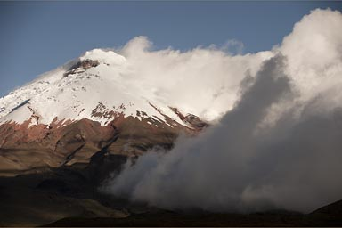 Cotopaxi, snow, clouds, blue sky.