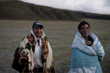 Cold up on Cotopaxi plateau. Indigenas wrapped in ponchos and blankets. Ecuador.