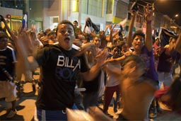 Tumbes, football cup victory celebrations in street at night.