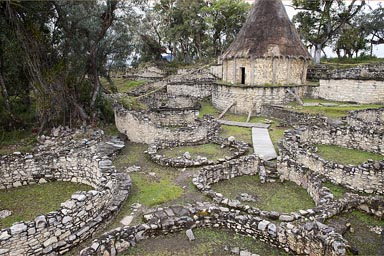 Inside the walls of Kuelap, reconstructed stone hut, residential quarters, Chachapoyas, Amazonas, Peru.