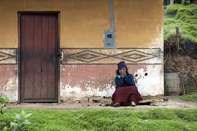 To sit outside her house, the same way as many hundreds of years ago, the painted decoration the same as in stone on the Kuelap walls.