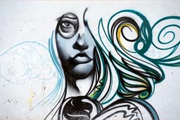 Graffiti in Huanchaco, woman and hair unfinished.