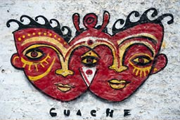 Guache graffiti in Huanchaco, Peru, 2 red masks, 3 eyes.