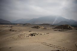Hazy are all days in desert Peru, along the coast, especially mornings, Caral pyramids 5,000 years old, Peruvian pre-Inca civilization.
