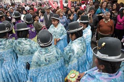 While waiting to parade, women from Puno, Independence Day in Peru.